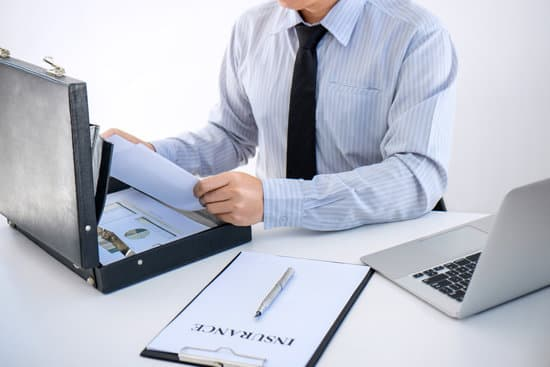Insurance concept, businessman signing a car insurance policy.